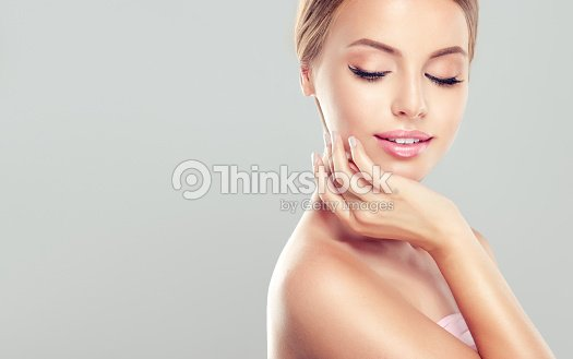 Young, smiling woman with clean, fresh, skin. : Stock Photo