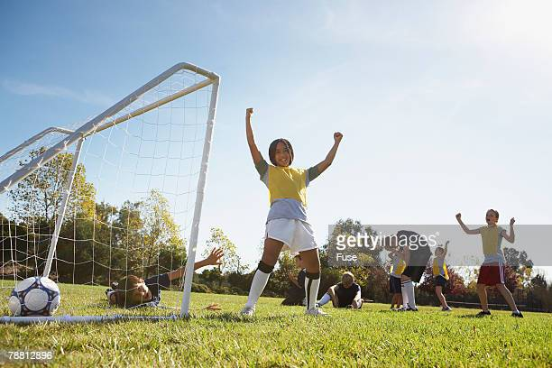 Young Soccer Player Cheering After Scoring Goal