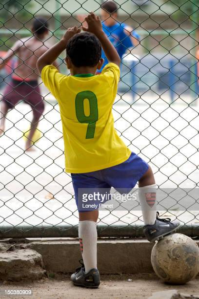 Young soccer player watching and waiting.