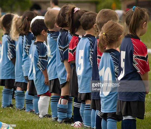 Young soccer players lining up for anthem