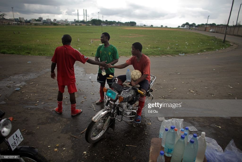 Young soccer players prepare to leave the field on a bike after a Sunday morning match, May 23, 2010 in Douala, Cameroon.
