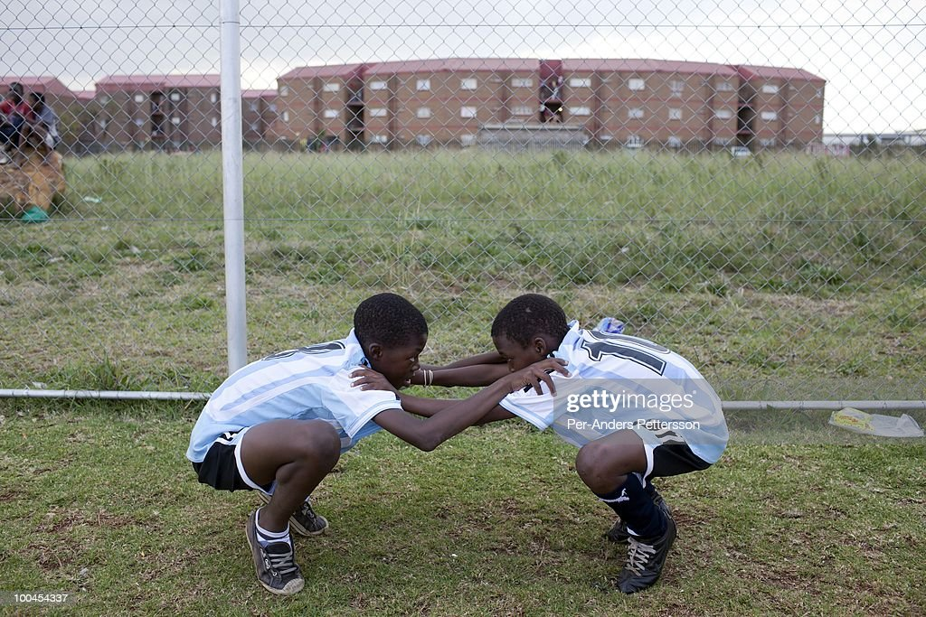 Young soccer players warm up before a street soccer game on May 15, 2010, in the Jabulani section in Soweto, Johannesburg, South Africa. Thousands of young boys play soccer in townships such as Soweto, dreaming about being the next big star. The upcoming World Cup soccer tournament in the country has greatly increased the soccer interest in the country.