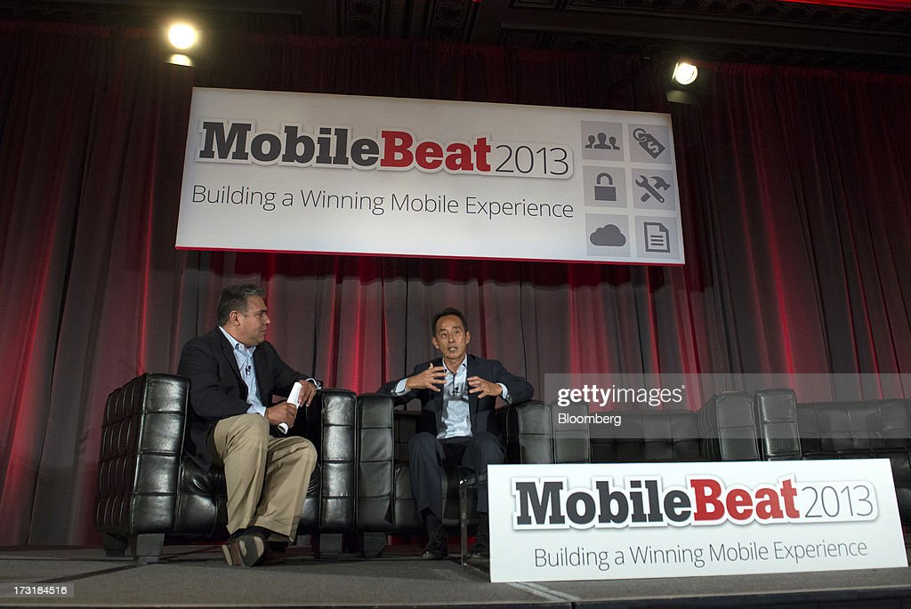 Young Sohn, president and chief strategy officer of Samsung Corp., right, speaks as moderator John China listens during the MobileBeat Conference in San Francisco, California, U.S., on Tuesday, July 9, 2013. MobileBeat, VentureBeats sixth annual flagship conference on the future of mobile, gathers members of the industry to look beyond design and implement a fully integrated experience. Photographer: David Paul Morris/Bloomberg via Getty Images