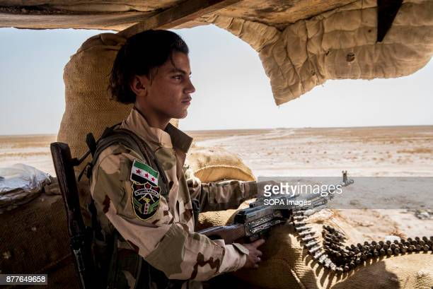 A young soldier from Quwat Al Nukhba stands guard on a forward post overlooking ISIS position in Al Shaddadi front lines The village that is held by...