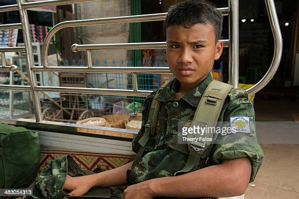 A young soldier from the Democratic Karen Buddhist army an ethnic Karen armed group which have signed a ceasefire with the government is sitting in...