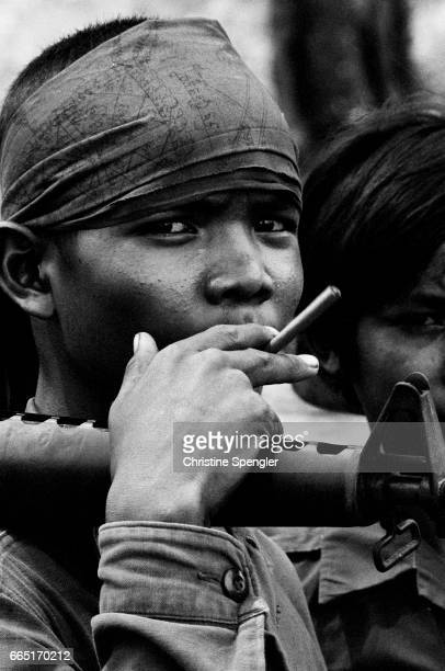 Young soldier of government forces Since the Lon Nol coup in March 1970 two groups fought for control of Cambodia the Khmer National Armed Forces...