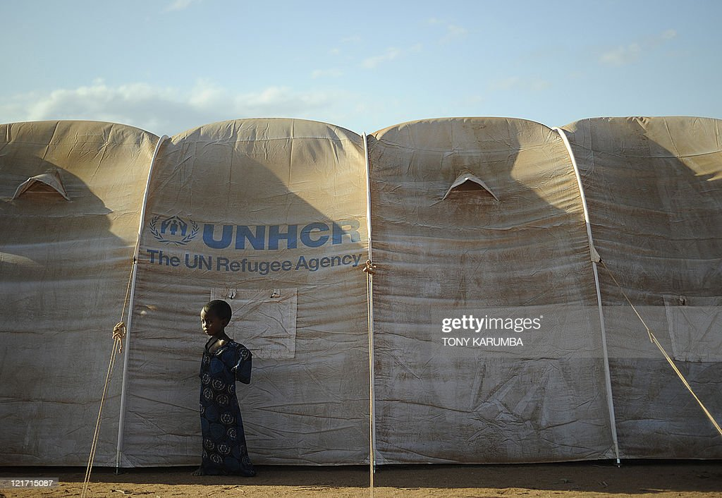 A young Somali refugee stands next to her family's shelter at the new Ifoextension in Dadaab on July 31 2011 The new site opened to some 5000...