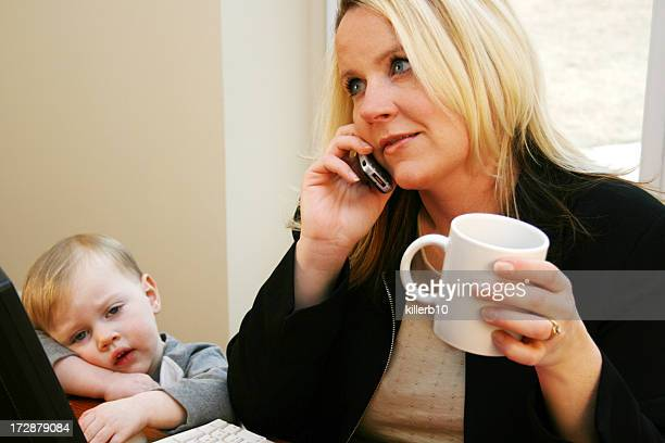 Young Son With His Career-Minded Mother