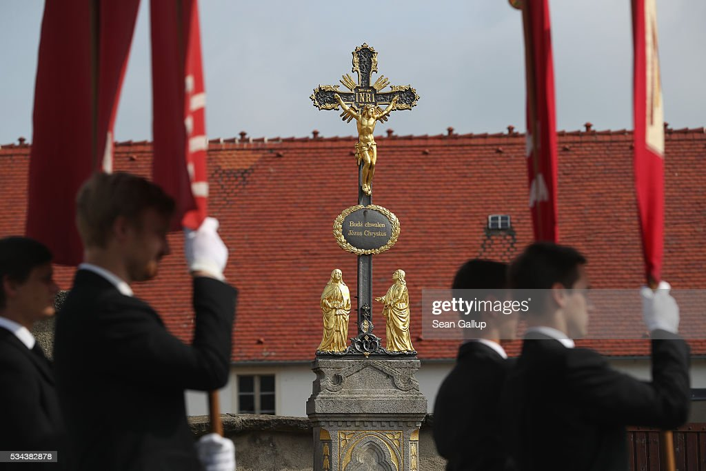 Young Sorbian men hold banners as they walk past a cross inscribed with text in Sorbian during the annual Sorbian Corpus Christi procession through the village center on May 26, 2016 in Crostwitz, Germany. Sorbians are a Slavic minority in southeastern Germany who speak a language similar to Czech and Polish. Sorbian is still taughet in some schools in the region and a lively tradition of Sorbian literature, theater and folk culture has survived.