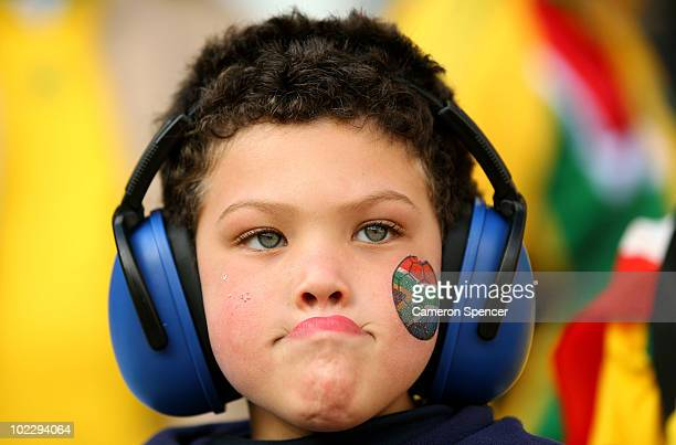 A young South Africa fan wears ear muffs prior to the 2010 FIFA World Cup South Africa Group A match between France and South Africa at the Free...
