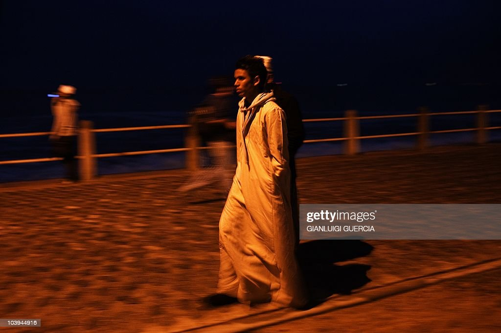 A young South African muslim boy walks on as thousands of South African muslims celebrate Eid al Fitr marking the end of the fasting month of Ramadan on September 9, 2010 ahead of the evening prayer on the Sea Point promenade in Cape Town, South Africa. During the month of Ramadan, Muslims observe a strict fast and participate in pious activities such as charitable giving and peace-making. It is a time of intense spiritual renewal for those who observe it. At the end of Ramadan, Muslims throughout the world observe a joyous three-day celebration called Eid al-Fitr (the Festival of Fast-Breaking). Eid al-Fitr falls on the first day of Shawwal, the month which follows Ramadan in the Islamic calendar. It is a time to give in charity to those in need, and celebrate with family and friends the completion of a month of blessings and joy.