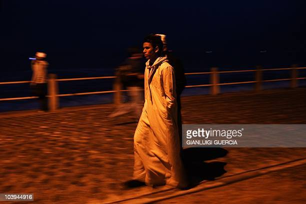 A young South African muslim boy walks on as thousands of South African muslims celebrate Eid al Fitr marking the end of the fasting month of Ramadan...