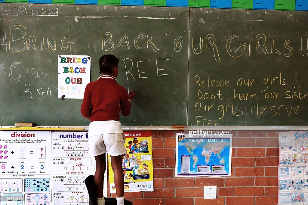 A young South African student at a primary school in Durban writes a message on a blackboard during a 'BringBackOurGirls' school project calling for the immediate release of over 200 abducted Nigerian school girls, on May 15, 2014. Several protests actions were being held worldwide to protest the abduction of over 200 girls by members of the Islamist Boko Haram group in mid-April and to call for their liberation.