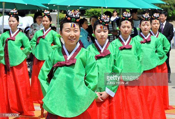 Young South Korean women wearing traditional costumes take part in the ComingofAge Day ceremony to mark their adulthood in Seoul on May 16 2011 About...