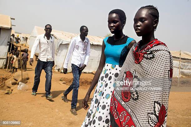 Young South Sudanese women Nyahok Peter and Nyabuong Gabriel16 walk together in the United Nations Missions In Sudan Protection of Civillians site in...