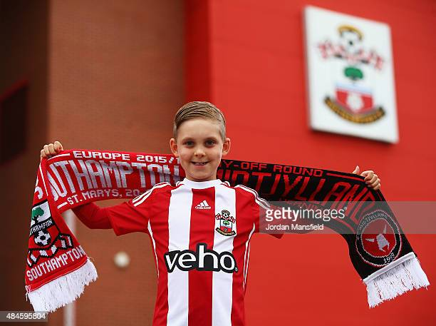 Young Southampton fan Marc Wareham poses outside the ground prior to the UEFA Europa League Play Off Round 1st Leg match between Southampton and...