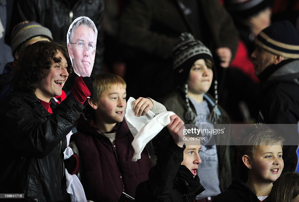 """Young Southampton fans show off a mask of former manager Nigel Adkins before their English Premier League football match against Everton at St.Mary's Stadium, Southampton, England, on January 21, 2013. USE. No use with unauthorized audio, video, data, fixture lists, club/league logos or """"live"""" services. Online in-match use limited to 45 images, no video emulation. No use in betting, games or single club/league/player publications."""