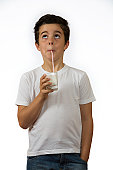 Young Spanish boy drinking milk with a straw