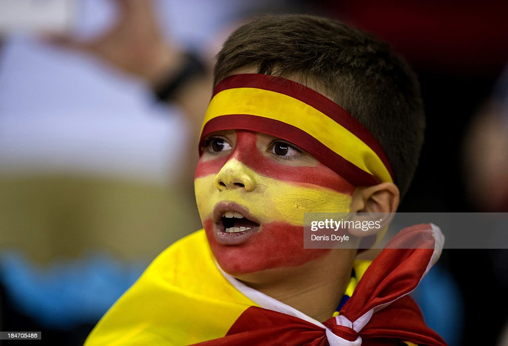 A young Spanish fan cheers on his team during the FIFA 2014 World Cup Qualifier between Spain and Georgia on October 15, 2013 in Albacete, Spain.