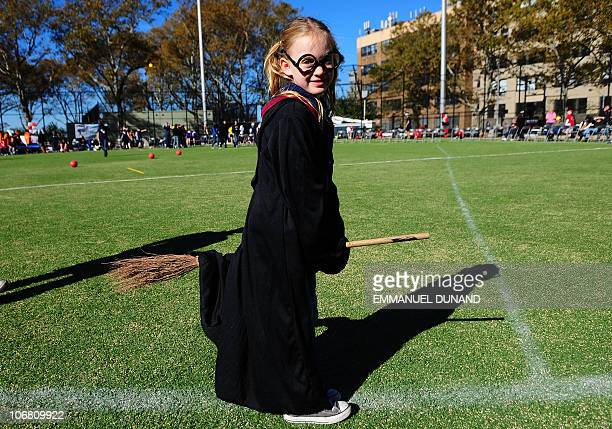 A young spectator rides a 'magic broom' during a Quidditch match Harry Potter's magical and fictional game during the 4th Quidditch World Cup in New...