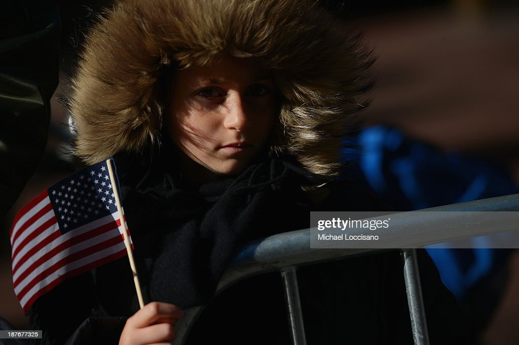 A young spectator watches the 94th annual New York City Veterans Day Parade on November 11, 2013 in New York City. The parade is the largest of its kind in the country and this year is especially dedicated to women serving in the armed forces.
