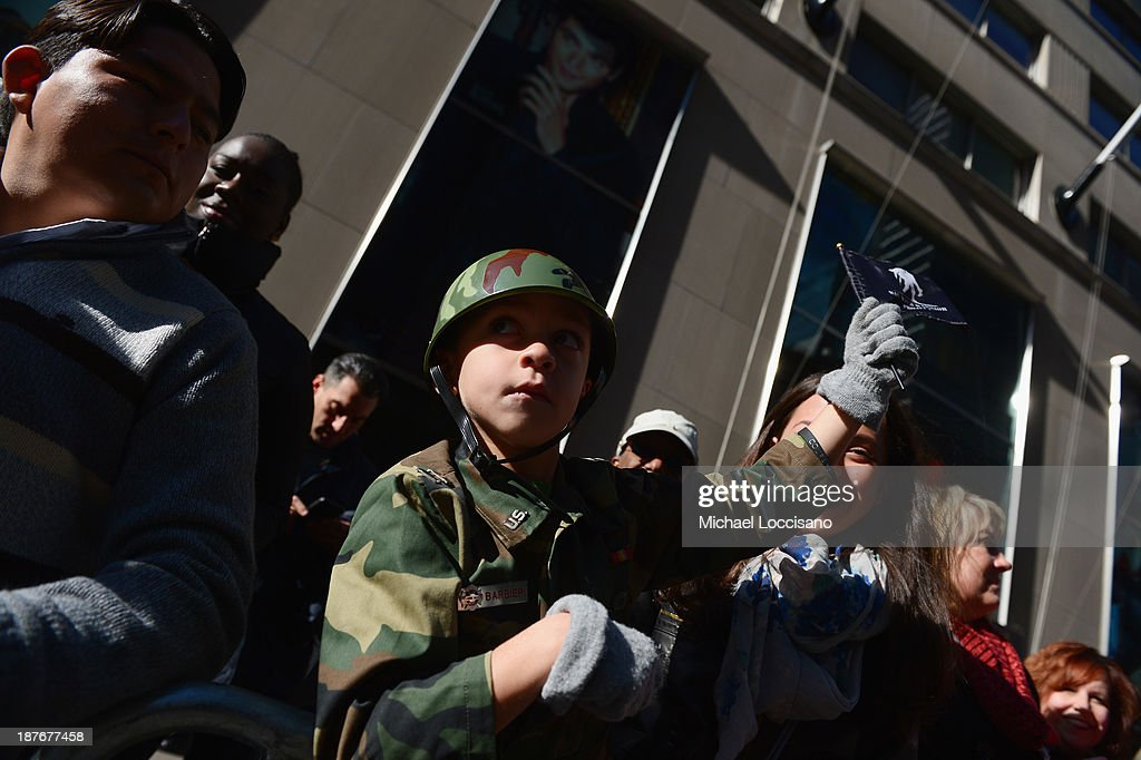 A young spectator watches the 94th annual New York City Veterans Day Parade on 5th Avenue on November 11, 2013 in New York City. The parade is the largest of its kind in the country and this year is especially dedicated to women serving in the armed forces.