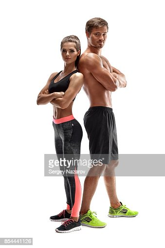 Young sportsmen couple woman and man in studio on white background : Stock Photo