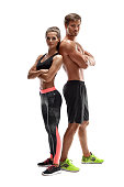 Young sportsmen couple woman and man in studio on white background. They look at the camera