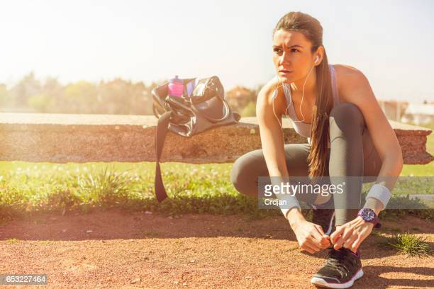 Young sportswoman preparing to run