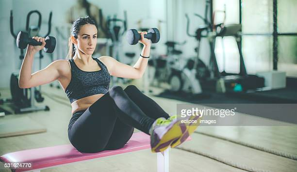 young sporty woman exercise at the gym