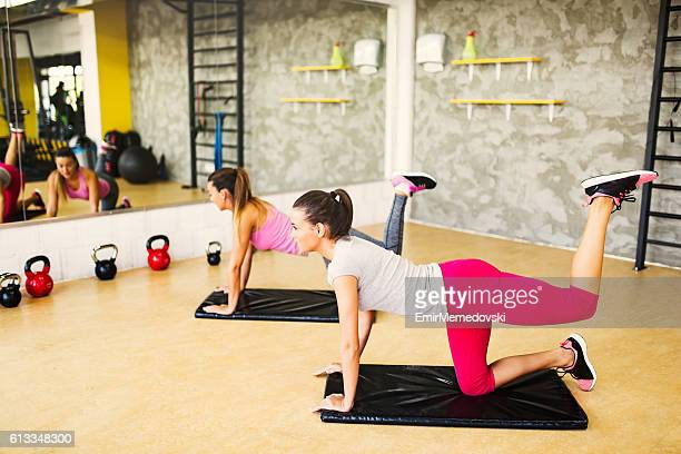 Young sporty women doing leg and buttocks exercises