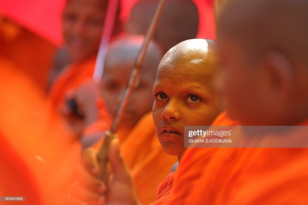 Young Sri Lankan Buddhist monks takes part in a rally calling for a ban on Islamic halal-slaughtered meat at Maharagama, a suburb of the capital Colombo, February 17, 2013. A new group known as the Bodu Bala Sena, or Buddhist Force, launched a drive to press for a boycott of all halal products in a country where the majority are Buddhists. AFP PHOTO/Ishara S