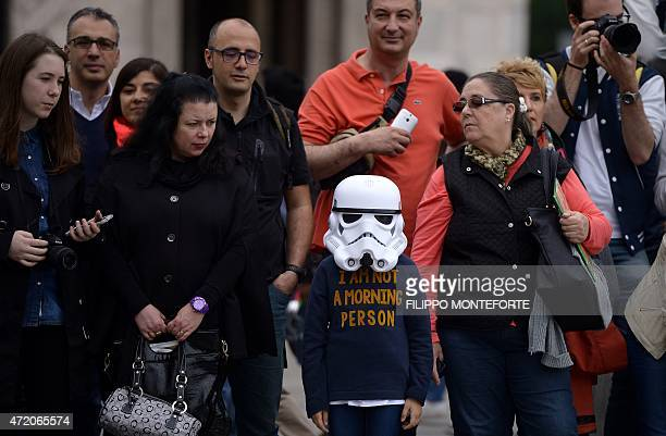 A young 'Star Wars' fan wearing a stormtrooper helmet attends an event marking Star Wars Day in Milan on May 3 2015 AFP PHOTO / FILIPPO MONTEFORTE