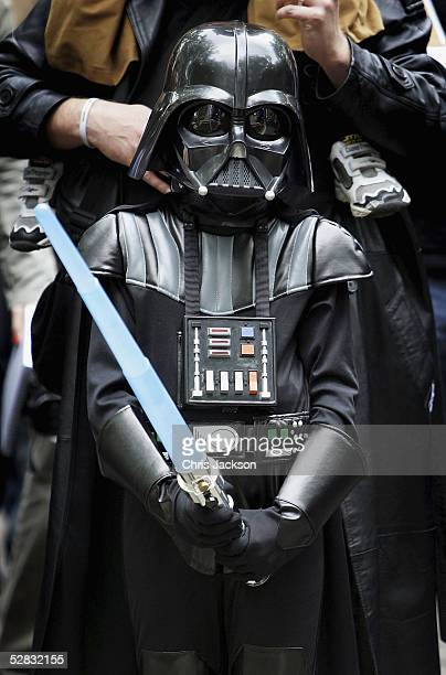 A young Stars Wars fan dressed as Darth Vader is seen watching the Royal Philharmonic Orchestra performing the score to The Star Wars Movie in...