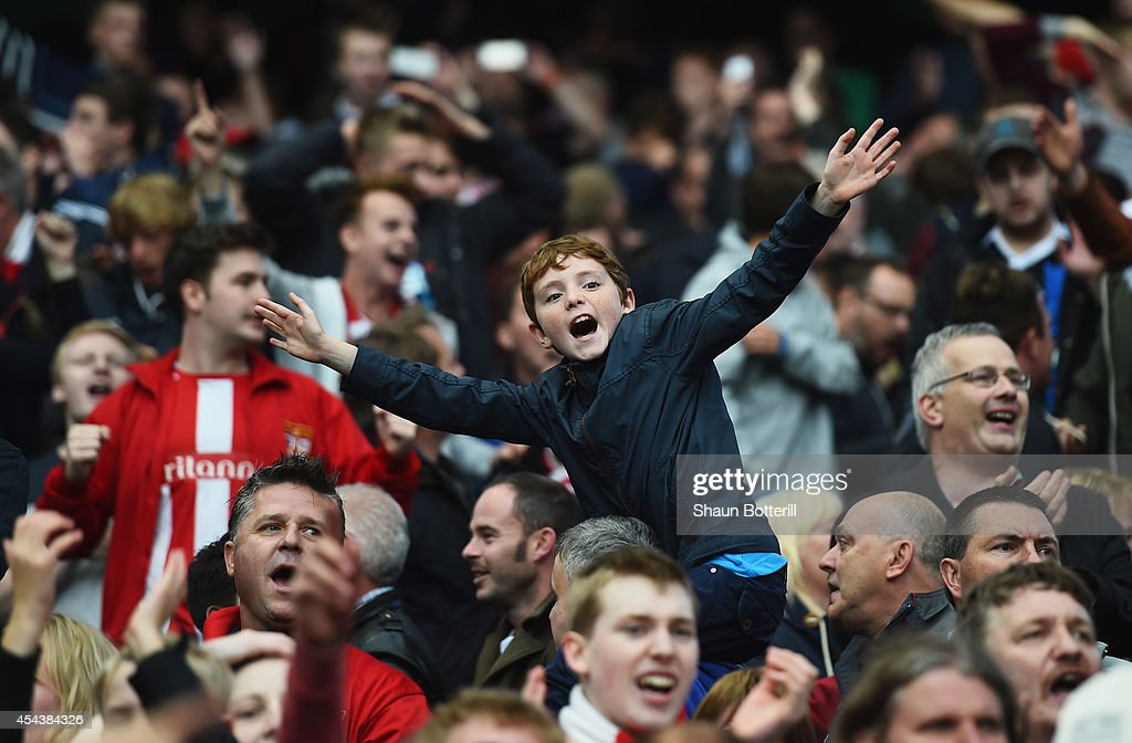 A young Stoke fan celebrates his team's victory after the Barclays Premier League match between Manchester City and Stoke City at Etihad Stadium on...