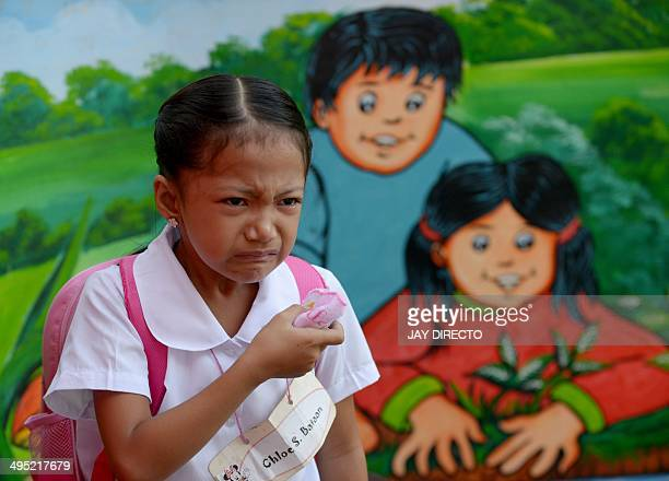 A young student cries as she goes to a government school for the first time in Manila on June 2 2014 The 201415 school year officially opened on June...