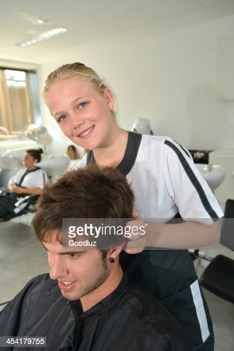 Young student doing scalp massage in hair salon : Stockfoto