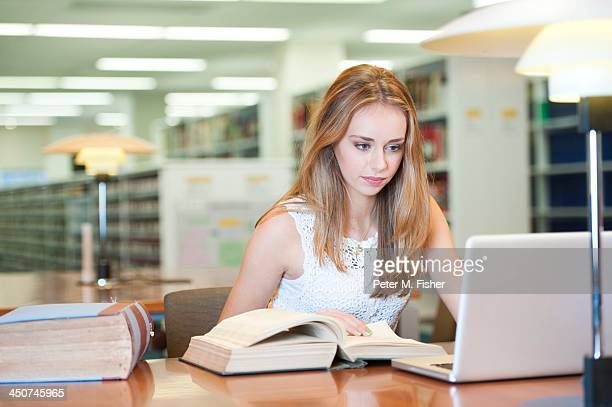 Young student in public library