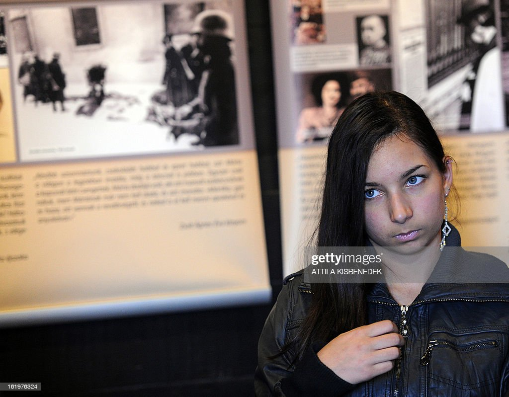 A young student listens to a history lesson in a train waggon that is part of an open air touring exhibition in Gyomro, Hungary, on February 18, 2013.The exhibition organized by the 'March of the Living' will tour to different cities in Hungary and has as central theme the deportation of Hungarian jews during World War II.