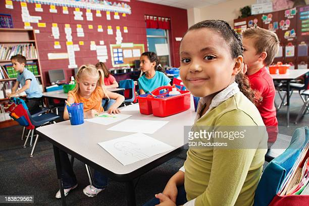Young student looking forward in classroom
