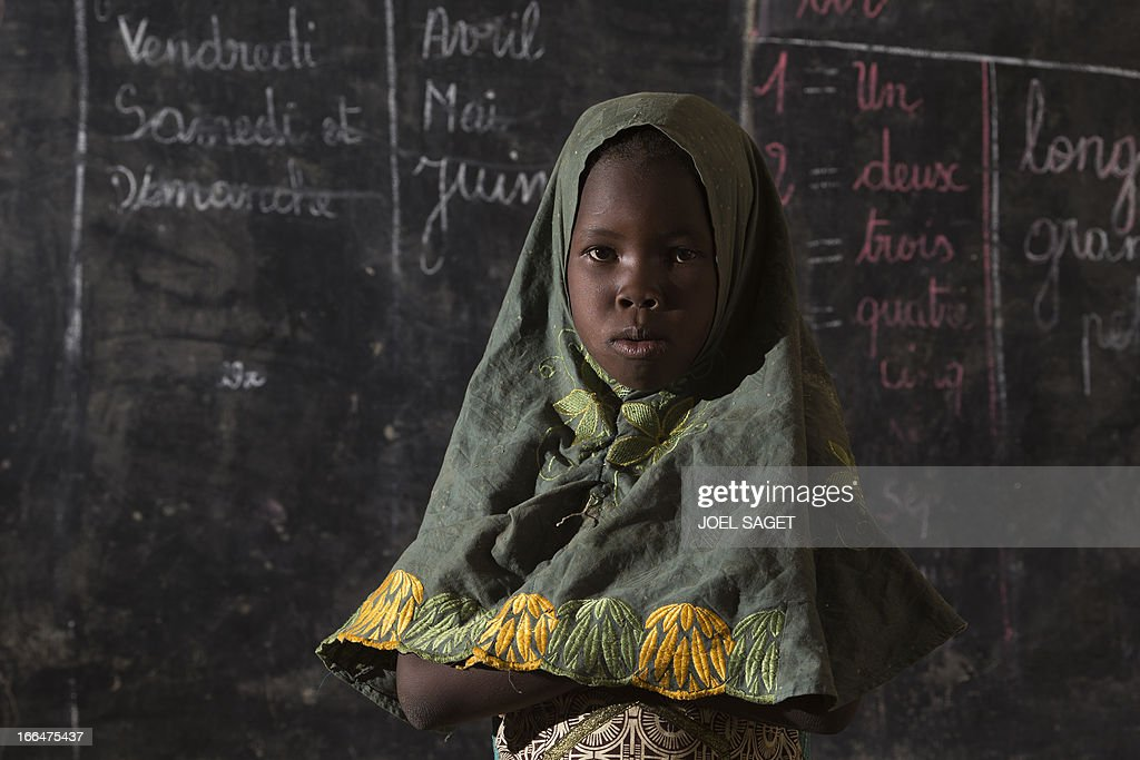 A young student poses in a classroom at Thionville Chateau school in Gao, Mali on April 12, 2013.