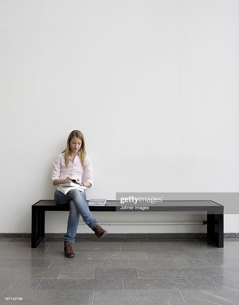 Young student sitting on bench