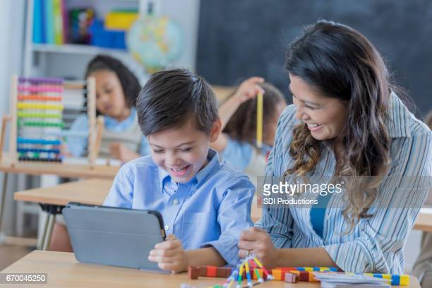 Young student uses digital tablet in class