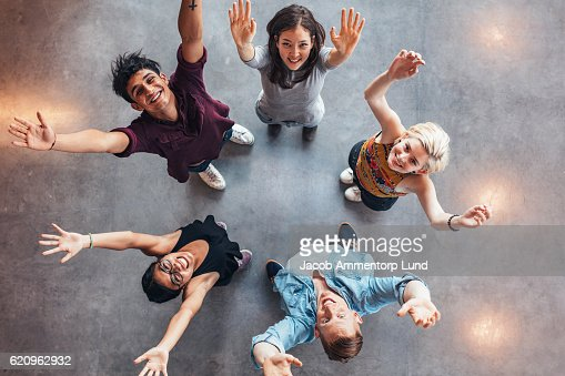 Young students celebrating success : Stock Photo