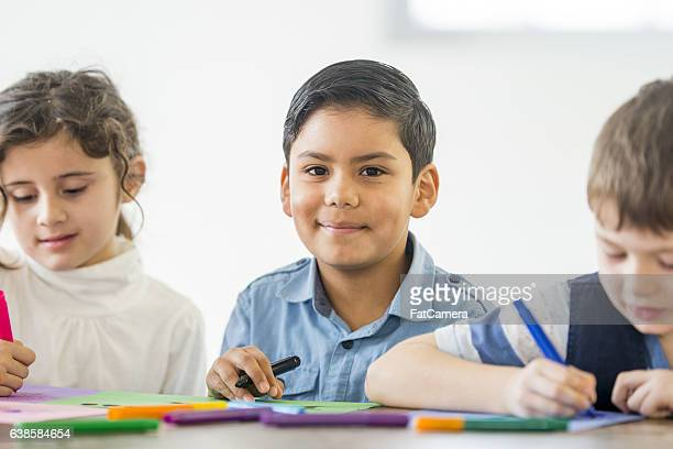 Young Students Coloring in Class