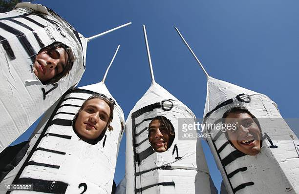 Young students Michael Arthur Nicolas and Quentin are dressedup in huge syringe they made up with cardboard all nightlong to denounce doping before...
