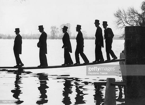 Young Students Of Eton College Must Leave Science Class By Walking A Wooden Plank On March 1 Due To The Floods Which Submerged The Outdoor Sports...