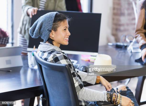 Young stylish Hispanic woman in meeting