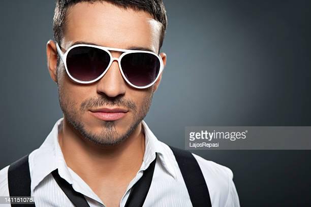 Young stylish man wearing sunglasses