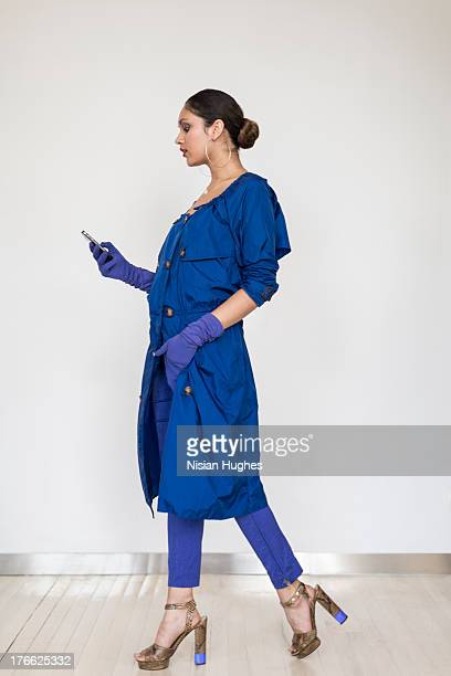 young stylish woman with cell phone